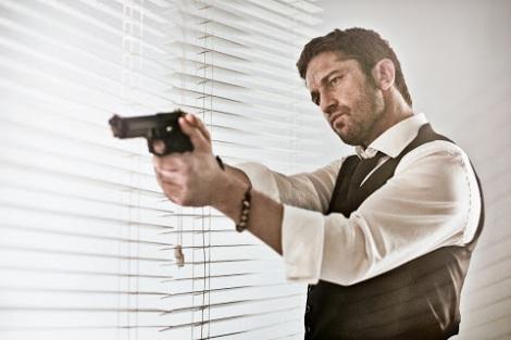 Gerard Butler firing a gun